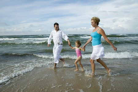 Happy family playing on the beach Stock Photo - 3790674