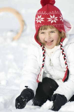 Happy girl playing on snow