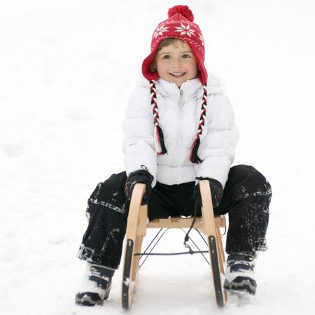 sledging people: Little girl on sledge Stock Photo
