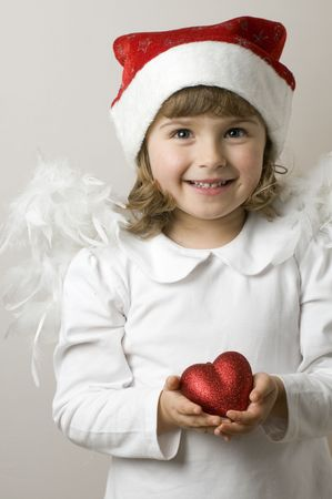 Christmas Angel with red heart Stock Photo - 3996483