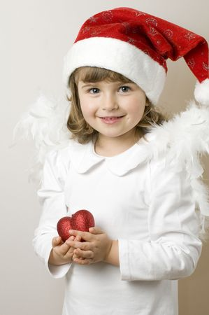 Christmas Angel with red heart Stock Photo