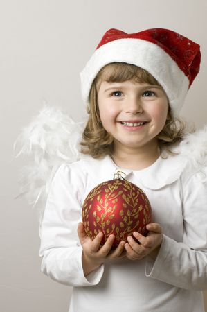 Christmas Angel with red glass ball Stock Photo - 3996484