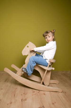 baby on chair: Little girl on rocking horse