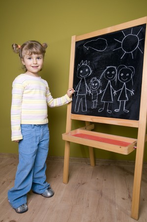 Cute girl drawing family at blackboard