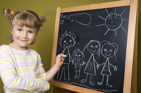 Cute girl drawing family photo