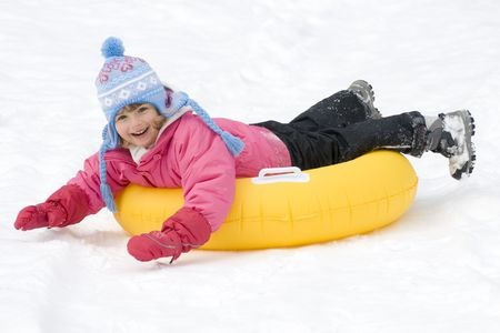 sledging people: Cute girl playing on snow Stock Photo