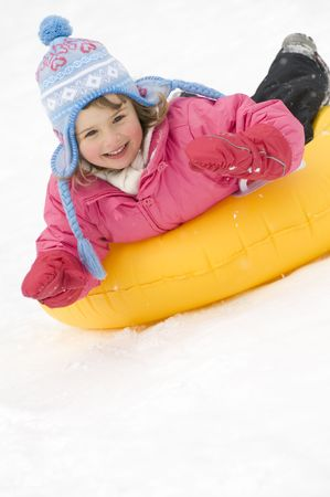 Cute girl playing on snow photo