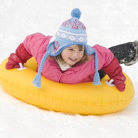 Girl playing on snow photo