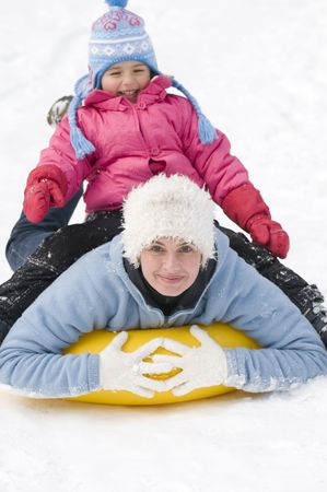 tubing: Family playing on snow Stock Photo