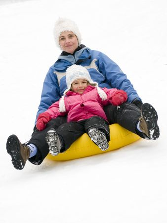 sledging people: Playing on snow
