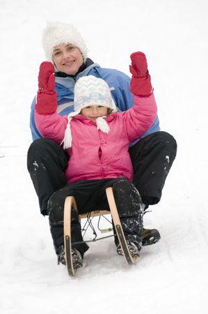 Sledding at winter time photo