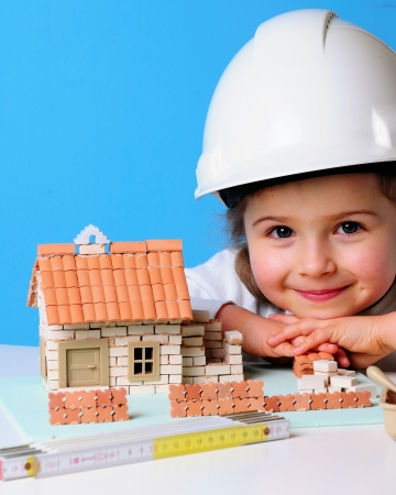 property investment: Little girl and house under construction