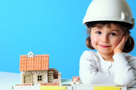 residence: Little girl and house under construction