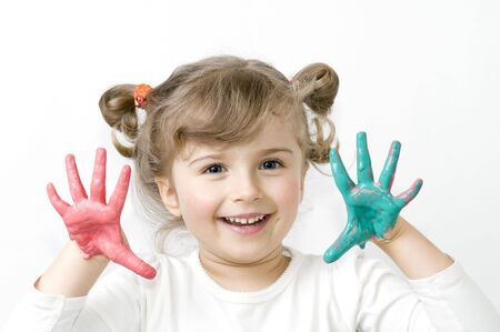 Cute girl playing with colors
