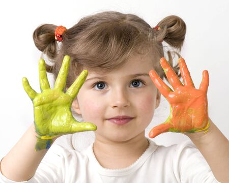 caucasian: Cute girl playing with colors