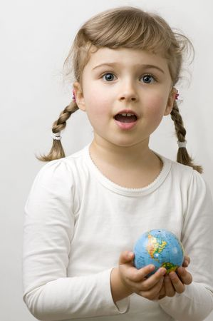 Globe on child hands Stock Photo - 4229998