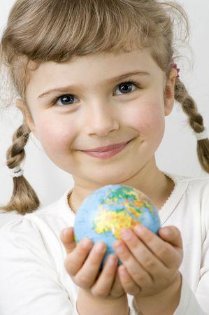 Globe on child hands Stock Photo