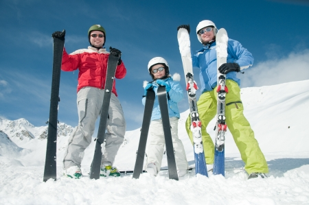 Happy family ski team photo