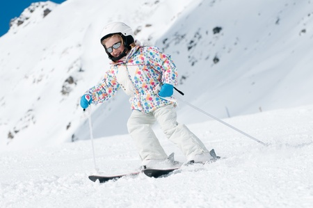 Happy little girl skiing downhill Stock Photo - 8344949
