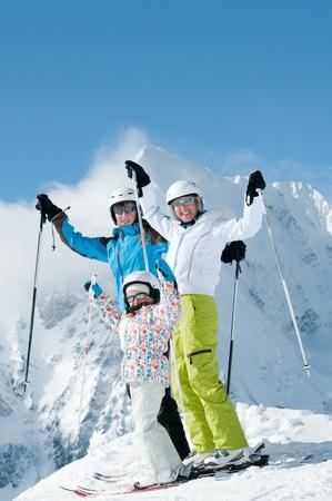 Happy family ski team photo