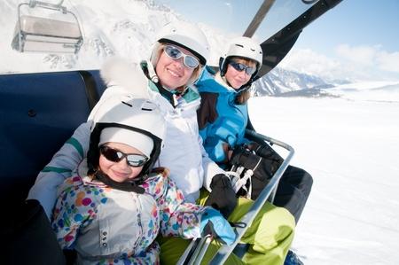 Family on ski lift photo