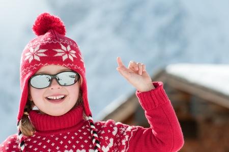 Little girl in winter resort photo