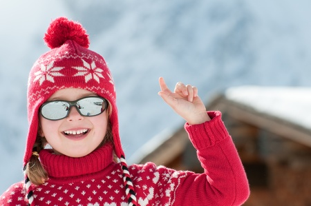 Little girl in winter resort photo