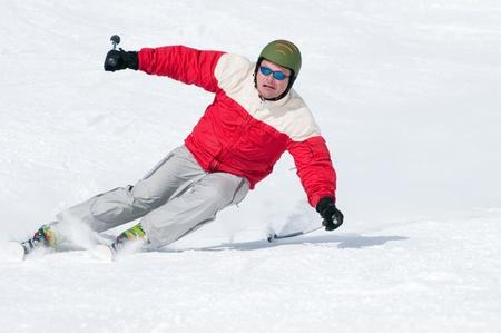 Skiing downhill photo