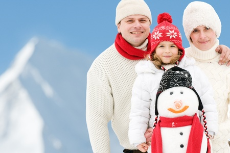 Happy family on winter vacation - copy space