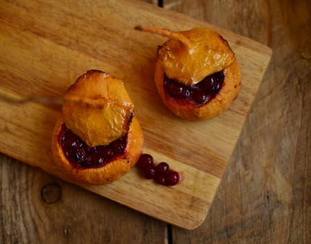 hardboard: Turnip filled (stewed) with cranberries and honey on the wooden hardboard