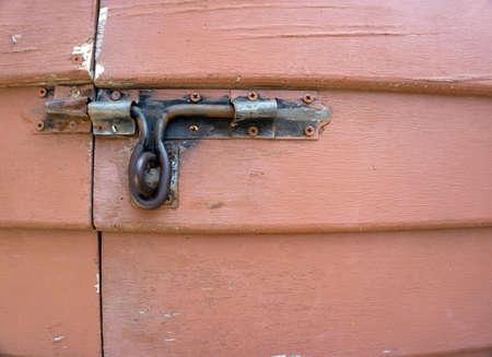 door handle: an old wood door with metal handle