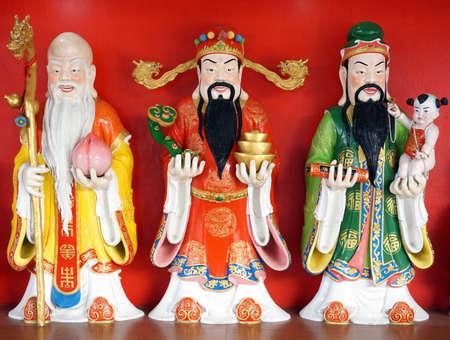 Lok Hong Xiu or Fu Lu Shou. Good Fortune Fu,Hok, Prosperity Lu,Lok, and Longevity Shou,Siu statue. Wat Samarnrattanaram, Chachoengsao, Thailand.