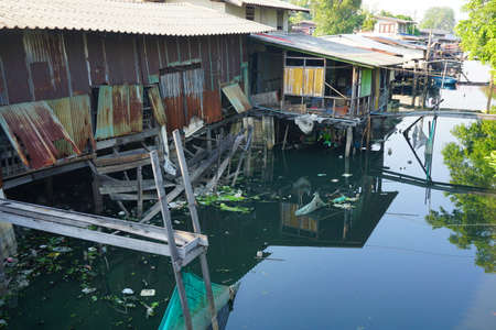 house float on water: House on stilts. Views of the citys Slums from the river in Bangkok, Thailand.