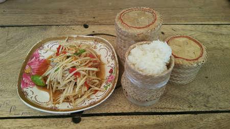 Spicy Papaya salad Som tum with sticky rice Banco de Imagens