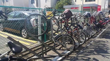 bike parking: TOKYO, JAPAN - October 09, 2015: Bike parking in Tokyo. 127 million people in Japan have 72 million bicycles.