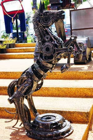 huahin: Hua-Hin beach,Thailand - 18 july 2016 : Recycled metal steel Robots theme park at Hua Hin Tique animal show : iron horse rearing up Editorial