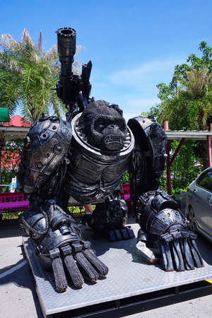 huahin: Hua-Hin beach,Thailand - 18 july 2016 : Recycled metal steel Robots theme park at Hua Hin Tique animal show : Iron ape monkey with giant gun Editorial