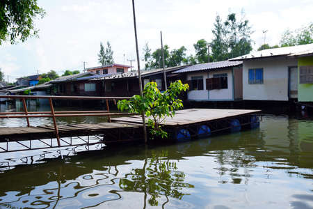 House on stilts. Views of the citys Slums from the river in Bangkok, Thailand.