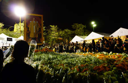 Bangkok,Thailand October 21 ,2016 : Thai people dressed in black come to offer condolences for Thailands late King Bhumibol Adulyadej in Sanam Luang at the Grand Palace in Bangkok