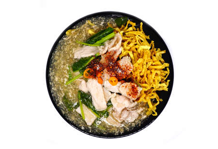 fried noodle: Crispy fried noodle pork with raadna sauce and top with thai chilli, One popular dish in Thailand. Stock Photo