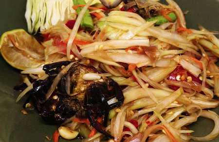 Traditional home made spicy food - Thai green papaya salad, locally known as Somtum