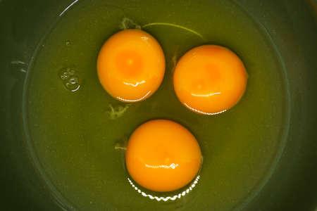 Egg yolke in green bowl