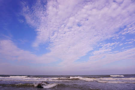 Blue sky ocean with clouds