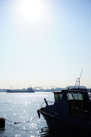 Silhouette of boat at the dock with blue sky