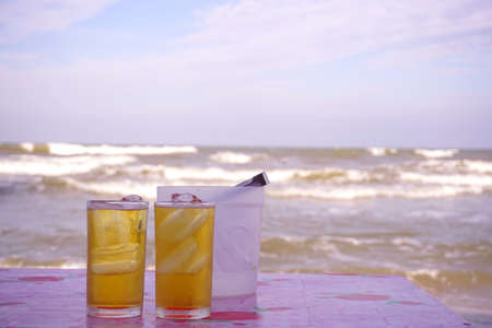 Cold beer with ocean background