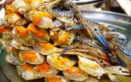 blue crab eggs was arranged on plate for sale on local market