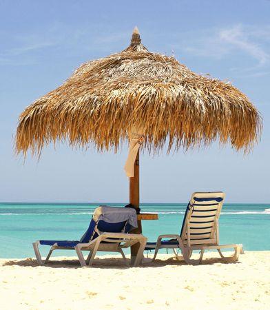 Lounge chairs on caribbean sea photo