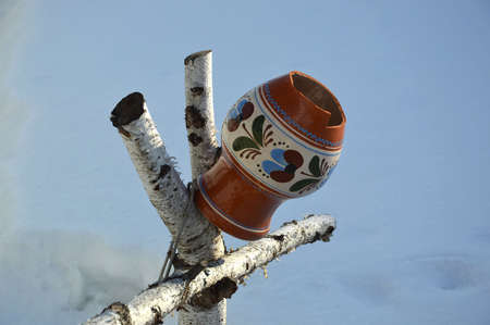 holey: leaky jug on a branch Stock Photo