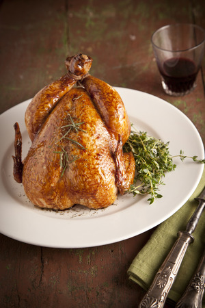 Grilled turkey and various vegetables on wooden plate for christmas and thanks giving day photo