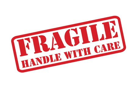 breakable: FRAGILE - HANDLE WITH CARE red rubber stamp over a white background.